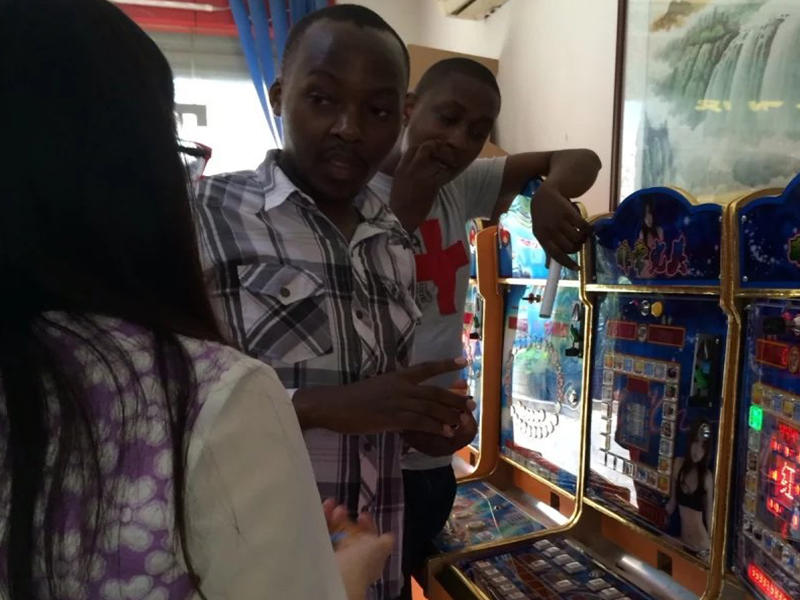 Showing Customers Arcade Game Machine and IC Card